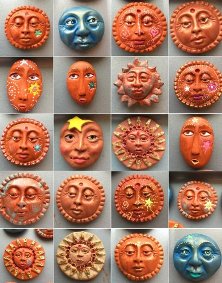Molded, altered, painted, some treated to artist grade gel pens. these are some of my latest kitchen magnets I made of polymer clay. Suns and moons. Dec. 2014. Karen A. Scofield.  My photos and blog entry are copyrighted, all rights reserved.
